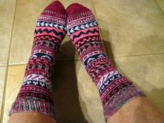 Socks made from leftover yarn from other socks in 2011 by Jill S.