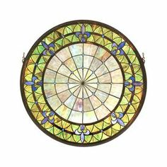 "Inspired by original Tiffany designs, this medallion-shaped stained glass window decor offers eye-catching appeal for your home.    Product: Stained glass window     Construction Material: Tiffany glass  Color: Multi      Features:   Intricate design    Reminiscent of castle and cathedral windows    Handcrafted    Dimensions: 30"" Diameter        Note: Mounting bracket and jack chain are included"