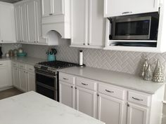 My Kitchen ❤️ - Zodiaq London Sky quartz countertops; Jeffrey Court 3x6 beveled tile backsplash in Mountain Mist in herringbone pattern; Kohler enameled cast iron sink (K-5826-0); Kohler Artifacts faucet (K-99259-CP); Samsung Dual-Fuel range (dual convection oven with dual door). Sherwin Williams Snowbound on cabinets; SW Colonnade Gray on walls; SW Silvermist on wall under the bar. All my design. :)