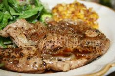 "Deep South Dish: Easy Pork Chop and Onion Bake..""seasoned simply with salt & pepper then seared, are finished with a slow bake in a flavorful beef broth with onions. Shown with a side salad and southern fried corn."""