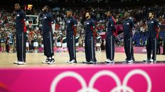 The United States team stands during the national anthem before taking on Argentina in the Men's Basketball semi-final match on Day 14.