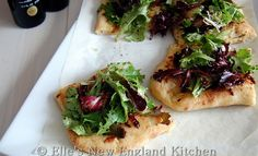 White Pizza topped with Spring Greens that have been tossed with Rapsberry Balsamic and Persian Lime Olive Oil - Elles New England Kitchen - FIORE Olive Oils and Balsamic Vinegars GIVEAWAY