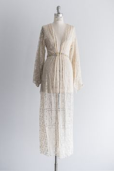 - Overview - To Purchase - Contract - DESCRIPTION: Very rare 1920's style dress dressing robe with ecru needle lace, large bell sleeves and front clasps. Available to rent for $65. Let me know that da