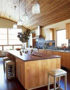 Aspen Kitchen. Love the rounded wood-paneled ceiling and the enormity it gives the space.