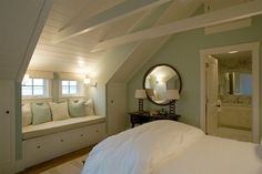 Attic converted into a gorgeous bedroom & bath! Open beams, soft colors, window bench make this room so appealing. Great use of normally wasted space.