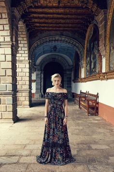 Model wears Maxi-Dress in Black Floral Print for lookbook photoshoot