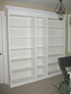 DIY built-in bookshelves.  Total project $250 - she paid abt $140 for the actual Billy bookcases at IKEA, the rest was price of paint, etc. - check out open end.