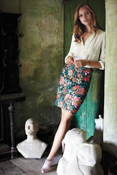 White blouse and patterned pencil skirt.