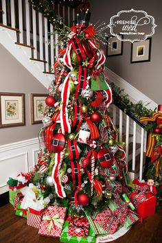 Our Owner, Dawn Schenkel, designed this spectacularly fun Santa tree!  www.premierwed.com Premier W.E.D. 2014 Holiday Happy Hour!