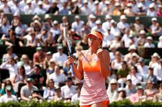 Maria Sharapova - 2014 French Open - Day Fourteen.Maria Sharapova of Russia celebrates a point during her women's singles final match against Simona Halep of Romania on day fourteen of the French Open at Roland Garros on June 7, 2014 in Paris, France.