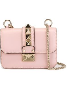 This rose pink leather Glam Lock shoulder bag from Valentino Garavani captures the very essence of Italian elegance.
