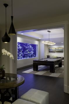 billiard room with massive saltwater aquarium