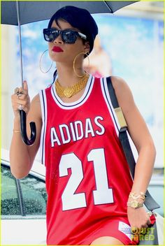 Rihanna carries her umbrella-ella and wears a basketball jersey dress while  stepping out on 0c723c483