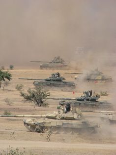 Indian Army's T-90 Bhishma tanks take part in a military training exercise in the Thar Desert, Rajasthan.