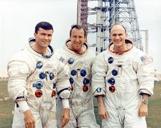 Omega Speedmaster Professional  Apollo XIII Prime Crew:  Haise, Lovell, Mattingly (l-r) wearing their Speedmasters.  Behind them, their spacecraft on the launch pad –the defective oxygen tank has aleady been installed.