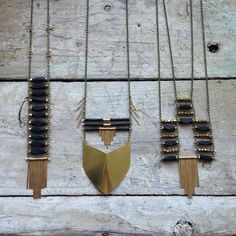 Brass, silver, black beads- love the mix of metals and material- graphic and gorgeous! (also great Jewelry DIY inspiration!) |Demimonde Studio and Shop|