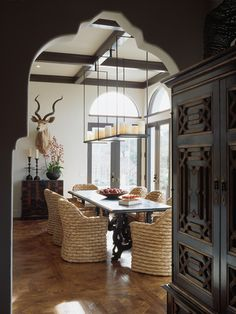 A few dream items all in one photo. arch detail, mismatch table and chairs, exposed beams, eclectic décor