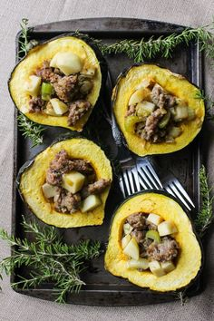 Sausage, apple and rosemary stuffed acorn squash. Only 10 ingredients for this healthy fall dinner! Gluten Free + Paleo + Dairy Free Option