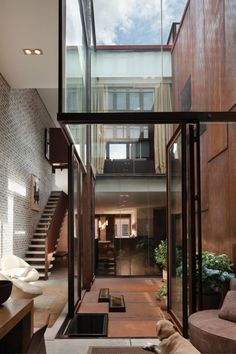 Inverted Warehouse-Townhouse / Dean-Wolf Architects in Manhattan, New York #livingroom #atrium