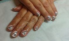 CND Shellac Rockstars Naked Naivete layered with Studio White with Sizzling Sand glitter, hand painted stripes,  stamped flowers and pearl rhinestones