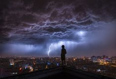 STORM BELOWA summer storm settles in over Beijing, China. Your Shot photographer Qing Hu captured this dramatic scene by using a long exposure of three seconds