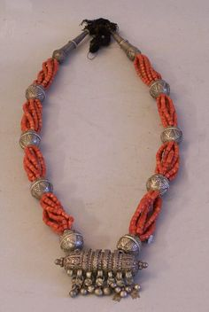 Yemen | Antique 19th century Yemeni Bawsani coin silver coral necklace with hirz. | It was made with strings of Mediterranean coral beads.
