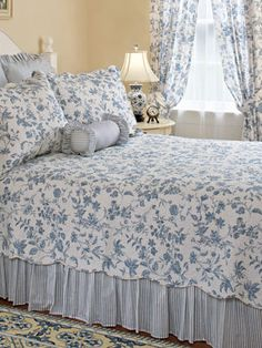 Blue toile--add a blue and white   vertical striped bed skirt. Yes please