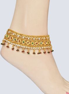 Stunning looking, a beautiful Indian traditional accessory for your feet called as anklet, pajeb or payal. A broad golden finish string in its exclusive golden designing studded with shining white, red and green color stones and beads making you look stylish and trendy. Can be worn on any outfit.