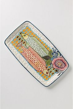 """Amazon Dreams Platter. Stoneware fish swim up a surreal river of vibrant dots and flourishing flowers.  Stoneware.  Dishwasher and microwave safe.  18.5""""L, 10.5""""W   #073820  $58.00 Color:Yellow  http://www.anthropologie.com/anthro/catalog/productdetail.jsp?id=073820&catId=HOME-SERVE&pushId=HOME-SERVE&popId=HOME&navAction=top&navCount=192&color=072&isProduct=true&fromCategoryPage=true&subCategoryId=HOME-SERVE-COLLECTIONS"""