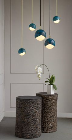 The Benedict pendant celebrates the defining detail of the Benedict Series. Two nested spun brass hemispheres cradle a hand blown glass globe. This fixture lends itself to creative configuration of our many finishes meaning its sure to be a stunning