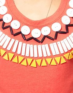 Jazz up a tee with some buttons and beads