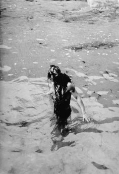 FAMAG 2004.2.4 | Penrose, Sir Roland (1900-1984): Max Ernst and seaweed, Lambe Creek, photograph, 29.3 x 23 cms. Purchased with grant aid from the Esmee Fairbairn Foundation in 2004. © Roland Penrose Estate. All rights reserved. | The Permanent Collection | Falmouth Art Gallery