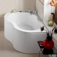 Corner bath.  What I would get if the kids didn't want a big jacuzzi tub