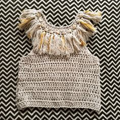 Welcome to our PARADISE COLLECTION with the Ivy Fringe Top. Hand crochet with soft chunky yarn the Ivy Fringe Top is an amazing statement piece thi...
