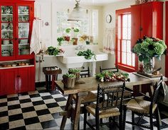 Cupboards and window in red trim, black and white checkered floor, antique sink and love the chairs!