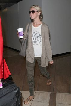 : Julianne Hough stayed in neutral territories in camouflage jeans, a white tee, and beige cardigan at the airport.