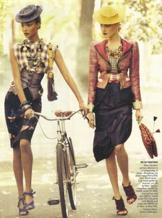 what a girl should wear while biking - skirts, blazers, heels, and carefully-perched hats