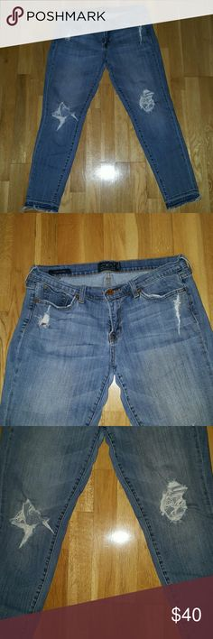 Lucky Brand Jeans size 10/30 Distressed Lucky Brand Jeans both knees ripped out.. very stylish Lucky Brand Jeans Skinny