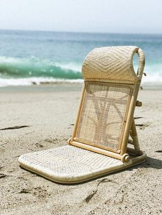 Our lightweight, flat folding, natural rattan beach chair is handmade with the highest quality rattan from Bali. Featuring a comfortable shoulder strap for convenient travel. Perfect for the beach, camping, picnics, events, and more! Sustainably designed in Los Angeles & ethically made in Bali.Don't be fooled when you see lower prices through other sellers. We encourage you to look closely at our beach chairs and compare them to other listings. Pay attention to rattan placement, weave, color Beach Lounge Chair, Beach Chairs, Rattan, Wicker, Beach Picnic, Beach Camping, Leather Label, Beach Umbrella, Us Beaches