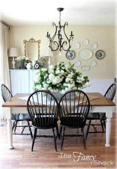 Crisp pretty dining room... table base painted with Annie Sloan chalk paint in Old White, plates on wall, chandelier is from