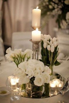 white spring wedding centerpiece / http://www.himisspuff.com/simple-elegant-all-white-wedding-color-ideas/