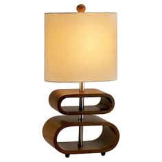 Walnut-finished table lamp with an openwork wood base.   Product: Table lamp Construction Material: Wood, metal ...
