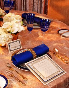 royal blue napkins with silver holders, White  Table Cloth with Royal Blue Lace on top of Silver or White or Silver Lace on top of White, Royal Blue Glasses Silverware