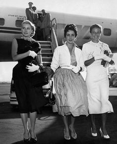 Grace Kelly, Elizabeth Taylor, Laraine Day / arriving in New York, 1954.