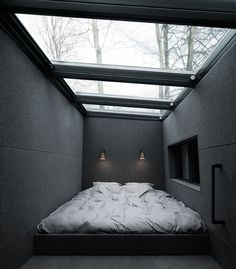 Prefab Gets a Makeover With Danish Industrial Design | A Velux skylight above the sleeping loft includes remote-controlled integrated blinds.