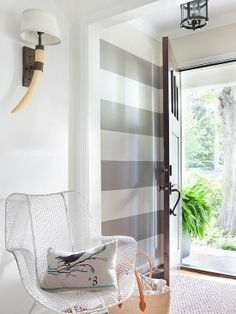 Good Life of Design: FOOLING THE EYE WITH STRIPES    large one shade ligther than walls sage and off-white stripes behind Grandfather clock.