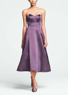 Anybridal party will gleam while capturing enchanting moments in this sensational tea length dress!  Strapless satin bodicefeatures sweetheart neckline that accentuates theneck and shoulders.  Dazzling intricate beading around the waist adds a touch of glam.  Full tea length skirt hits below the knee.  Imported. Back zip.Dry clean only.  Sizes and colors have availability.