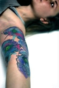 Watercolour-style floral tattoo // Peter Aurisch...I wouldnt get this but it is very pretty!