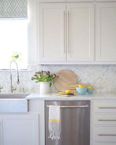 white kitchen + herringbone marble backsplash
