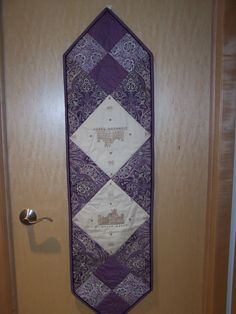 """My version of the Downton Abbey table runner using the Downton Abbey fabrics.  Note the flange binding and """"crown motif"""" quilting."""